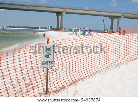 ORANGE BEACH, AL - JUNE 10: Beach-goers are asked to leave the area as a portion of Perdido Pass, AL is cordoned off on June 10, 2010. - stock photo