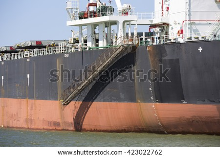 Orange black bulk ore carrier - stock photo