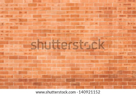 Orange block brick wall - stock photo