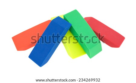 Orange, blue, yellow, green and red erasers arranged on a white background. - stock photo