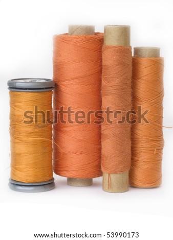 orange bobbin - stock photo