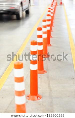 Orange Bollard inside carpark - stock photo