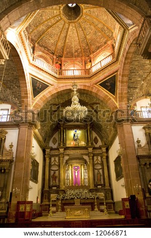Orange Brick Dome Chandelier Golden Altar Parroquia, Archangel Church, San Miguel de Allende, Mexico - stock photo