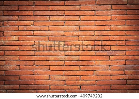 Orange brick wall. brick texture. brick pattern. Part of brick wall in vignette for background and design with copy space for text or image. Dark edged. - stock photo