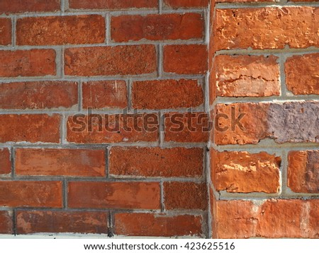 Orange brick wall with rough texture