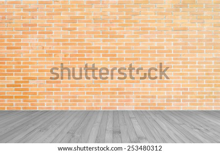 Orange-brown brick wall with wood floor    - stock photo