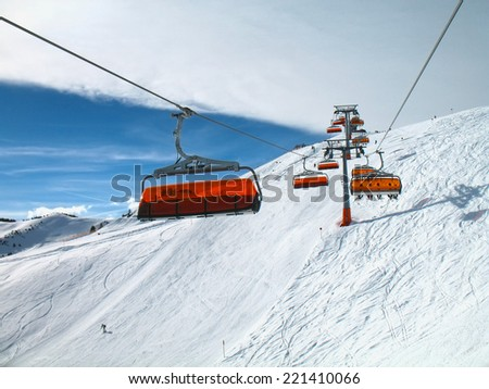 Orange bulbs of chair-lift, Ischgl, Austria.