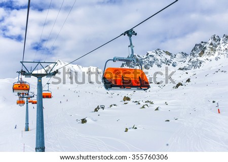 Orange bulbs of chair-lift, Ischgl, Austria Alps.