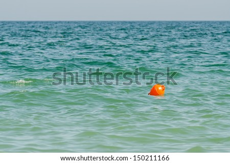 Orange Buoy Floating In Ocean