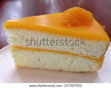 Orange cake on white plate  - stock photo