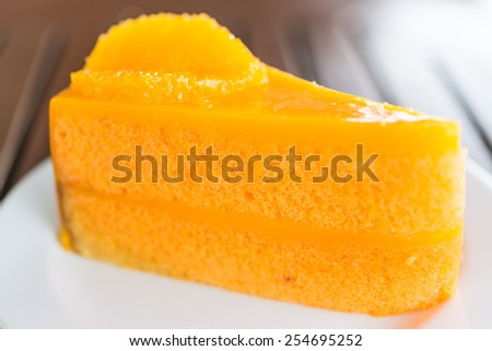 Orange cakes in white plate on wooden tables - selective focus shot