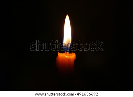orange candle light stock photo