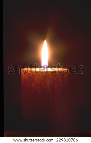 Orange Candle over black background - stock photo