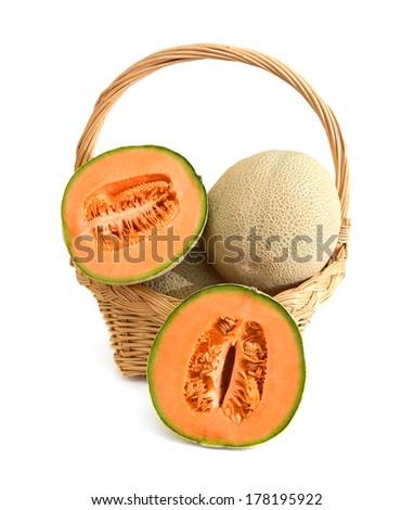 orange cantaloupe melon isolated in basket on white background  - stock photo