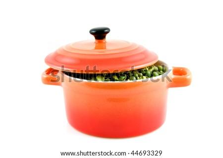 Orange casserole with split peas isolated on white background - stock photo