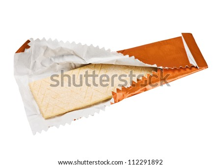 orange chewing gum is on the white background with paper - stock photo