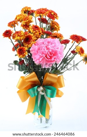 Orange chrysanthemum and pink carnation in glass vase on white background - stock photo