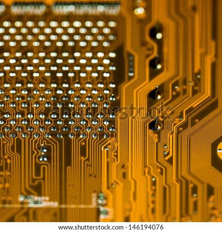Orange circuit board background, macro shot. shallow depth of field - stock photo