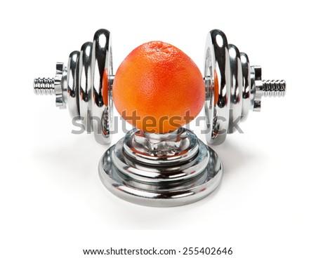 Orange citrus and dumbbell / weight training equipment on white background  - stock photo