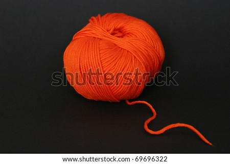 Orange clew on black - stock photo