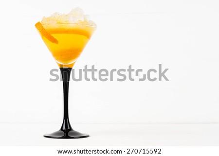 Orange cocktail in a martini glass - stock photo