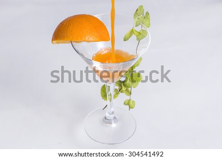 Orange cocktail in a martini glass - stock photo