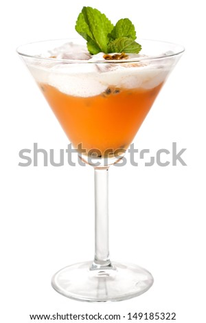 Orange cocktail with passion fruit and mint decoration