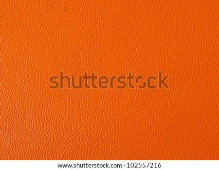 Orange color leather background - stock photo