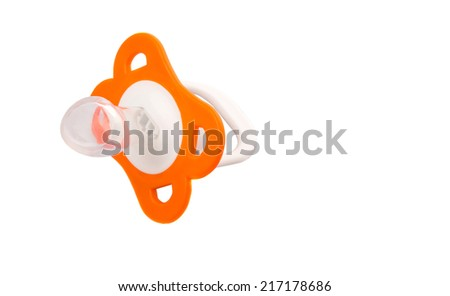Orange colored pacifier over white background - stock photo