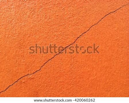 Orange concrete crack wall texture background  - stock photo
