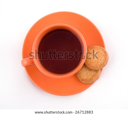 Orange cup of tea with cookie - view from top - stock photo