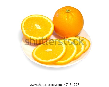 Orange cut into pieces and whole orange on a plate - stock photo