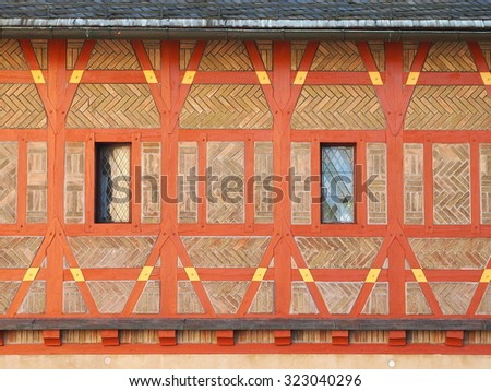 Orange decorated facade of a reconstructed medieval castle Karlstejn (Czech Republic). - stock photo