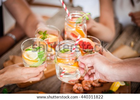Orange  Detox Water on wooden table