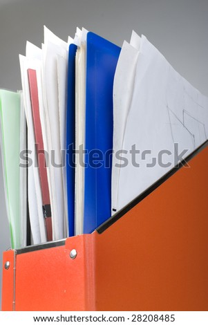 Orange documents folder with lot of papers - stock photo