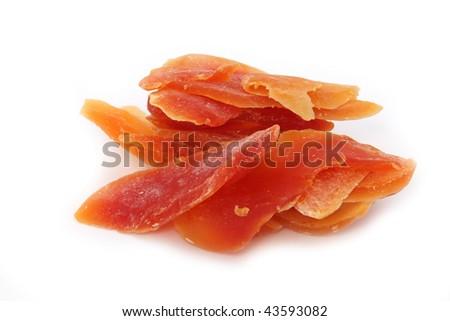 orange dried papaya slices over white background - stock photo