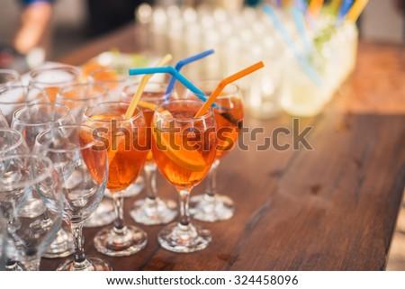 Orange drink with orange slice and ice - stock photo