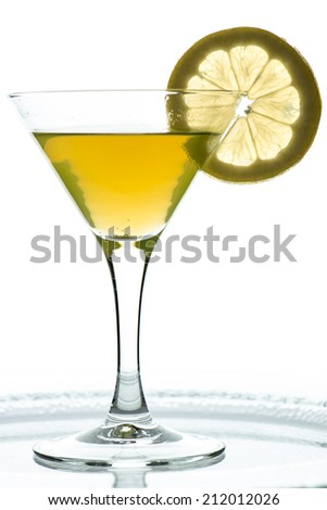 Orange drink with slice of lemon in a glass
