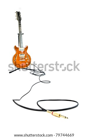 orange electric guitar and cord - stock photo