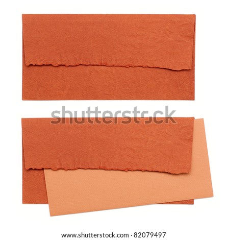 orange envelope by hand on a white background - stock photo
