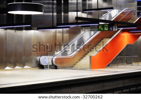 orange escalator in Munich subway