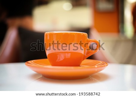 Orange espresso coffee cup - stock photo