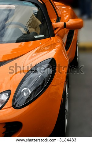 orange exotic sports car - stock photo