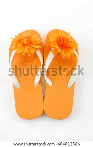 orange flip-flops with flowers - stock photo