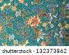 Orange flower pattern on blue fabric background - stock photo