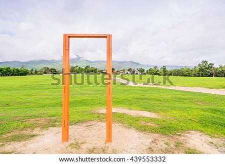 Orange frame in green field. - stock photo