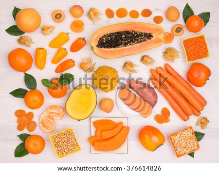 Orange fruit and vegetables containing plenty of beta carotene - stock photo