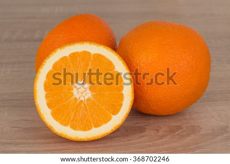 orange fruits on the wooden table in the kitchen