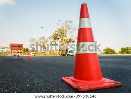 Orange funnel use for beware car on the road under construction. - stock photo