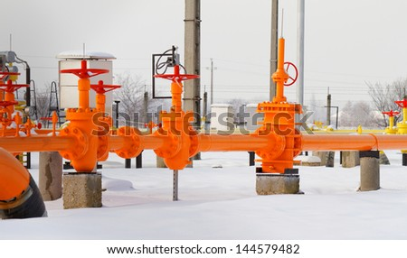 Orange gas pipe in frosted winter - stock photo